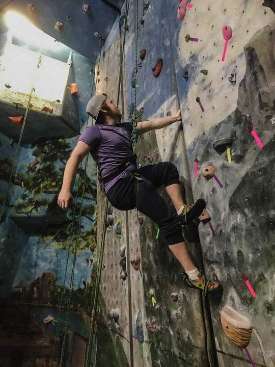Roahan climbs the rock wall