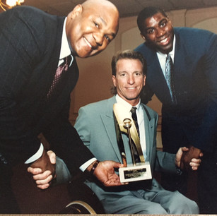 Jerry Buss Humanitarian Award presented by Magic Johnson and George Forman