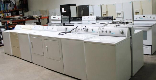 row of donated washing machines