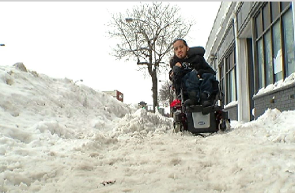 Wheelchair user unable to use snowy sidewalk