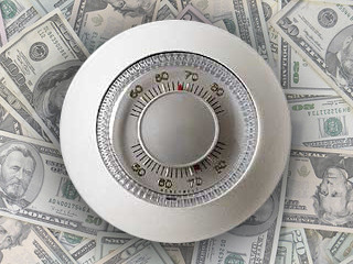 Thermostat on top of pile of money