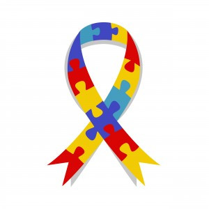 Ribbon showing interlocking jigsaw puzzle pieces in red, yellow, blue, and purple