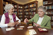 two older women playin cards
