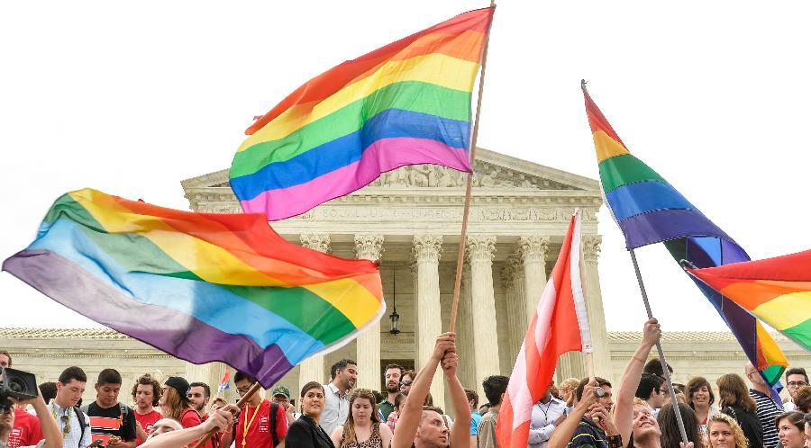 People waving flags celebrating marriage equality ruling outside supreme court