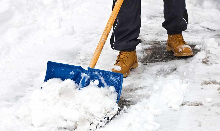 Snow shovel on sidewalk