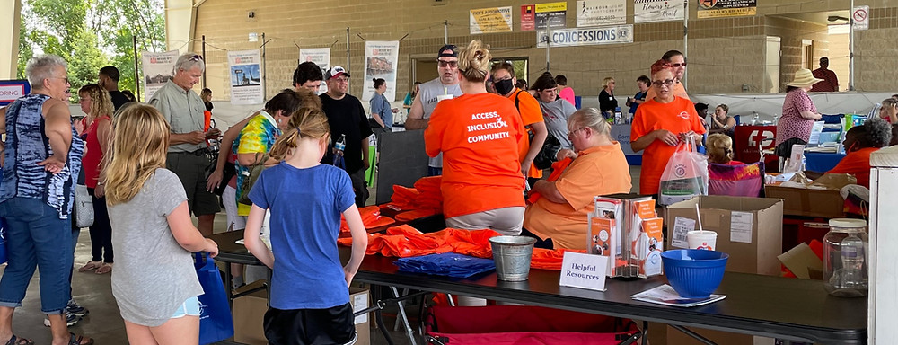 gathering of people at vendor tables during ADA event