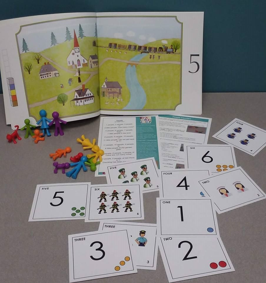 example of math kit shows books, flashcards, and colorful learning toys