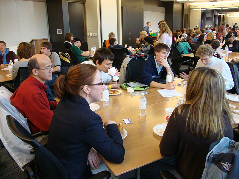 Students meet with mentors at the Dow Chemical Company