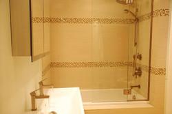 decorative tiles in bathtub surround