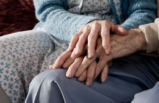 elderly-couple-holding-hands-pic-getty-i
