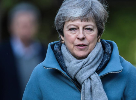 Parliamentary Brexit Takeover Flops as May Plans to Step Down