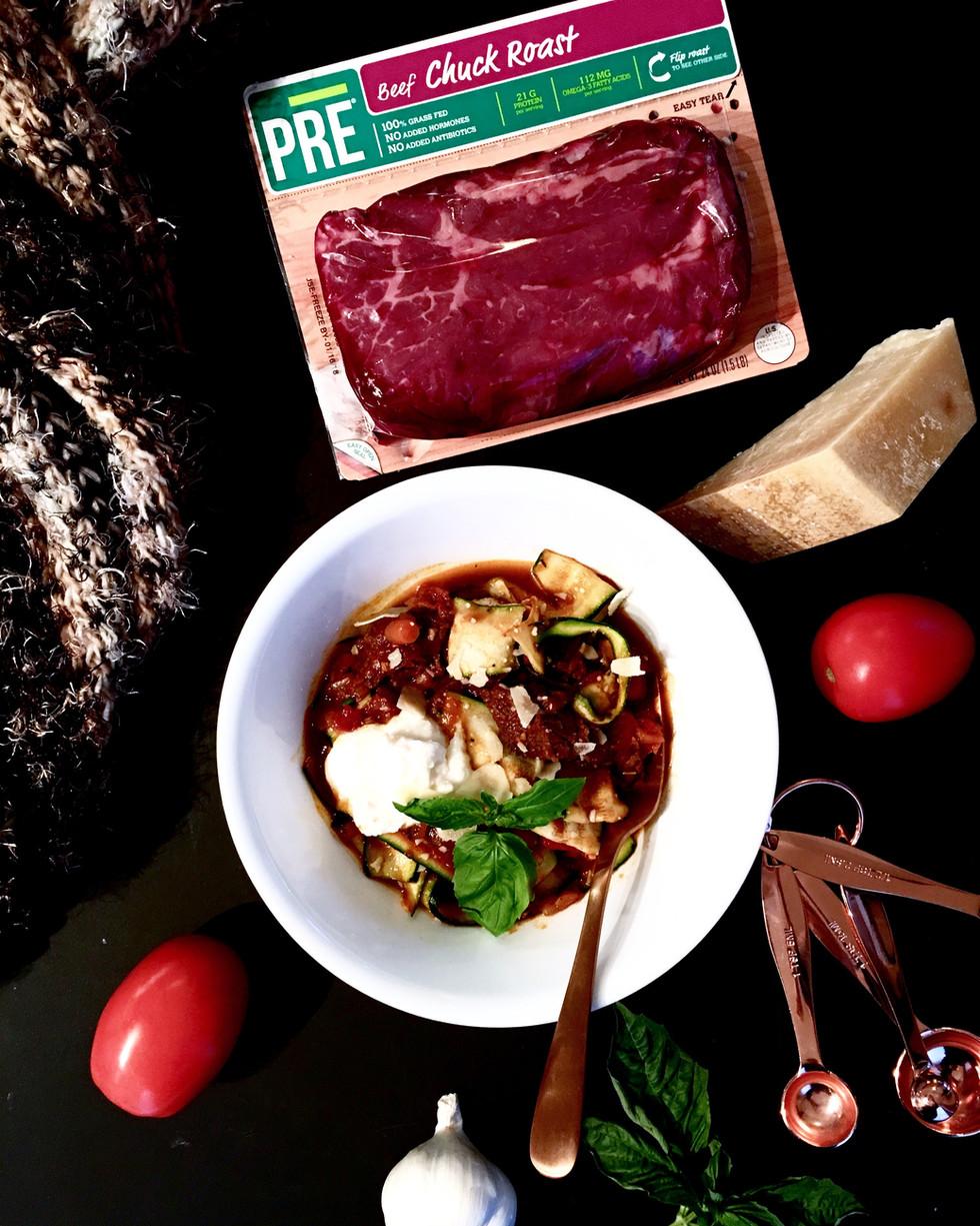 Pepper-Crusted Beef Ragu over Zucchini Ribbons