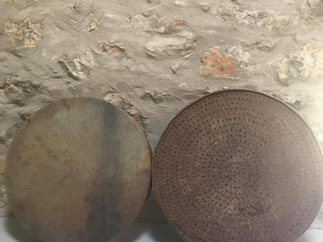 The Sacred Drum and the Grain Sieve