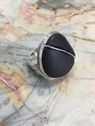 Beach stone with metal inlay set in sterling silver