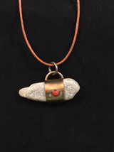 """""""Water Skipper"""" - natural stone surrounded by sterling silver with Rosarita stone on top"""