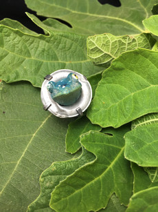 """""""Frog in Grommet"""" ring - designed from found objects, ceramic frog in metal grommet set in sterling silver"""