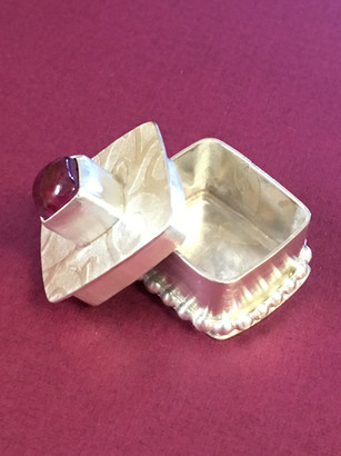 Memory keepsake container - imprinted sterling silver with decorated base topped with ruby stone setting