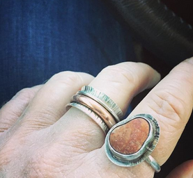 Zion stone and spinner rings