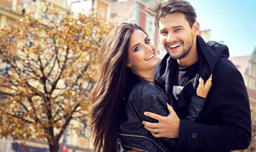 A Beautiful couple happy and hugging eachother with light, healthy, glowing skin from glutathione injections.