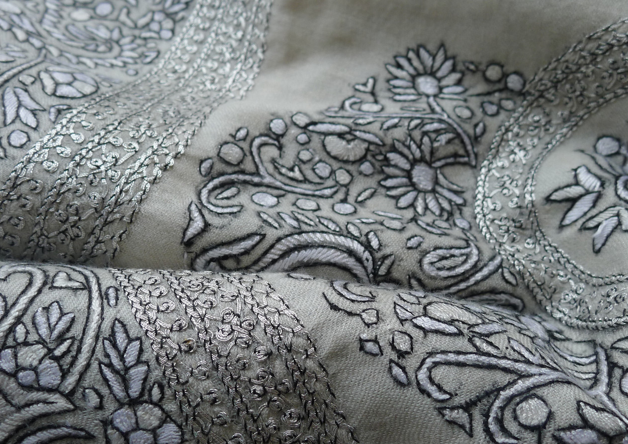 handwowen, hand embroided luxury ivory and silver  shawl. Contact us for more info and price.
