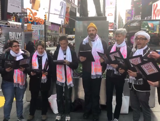GAGNog Carollers Brilliantly Satirize NRA Trump In Midtown