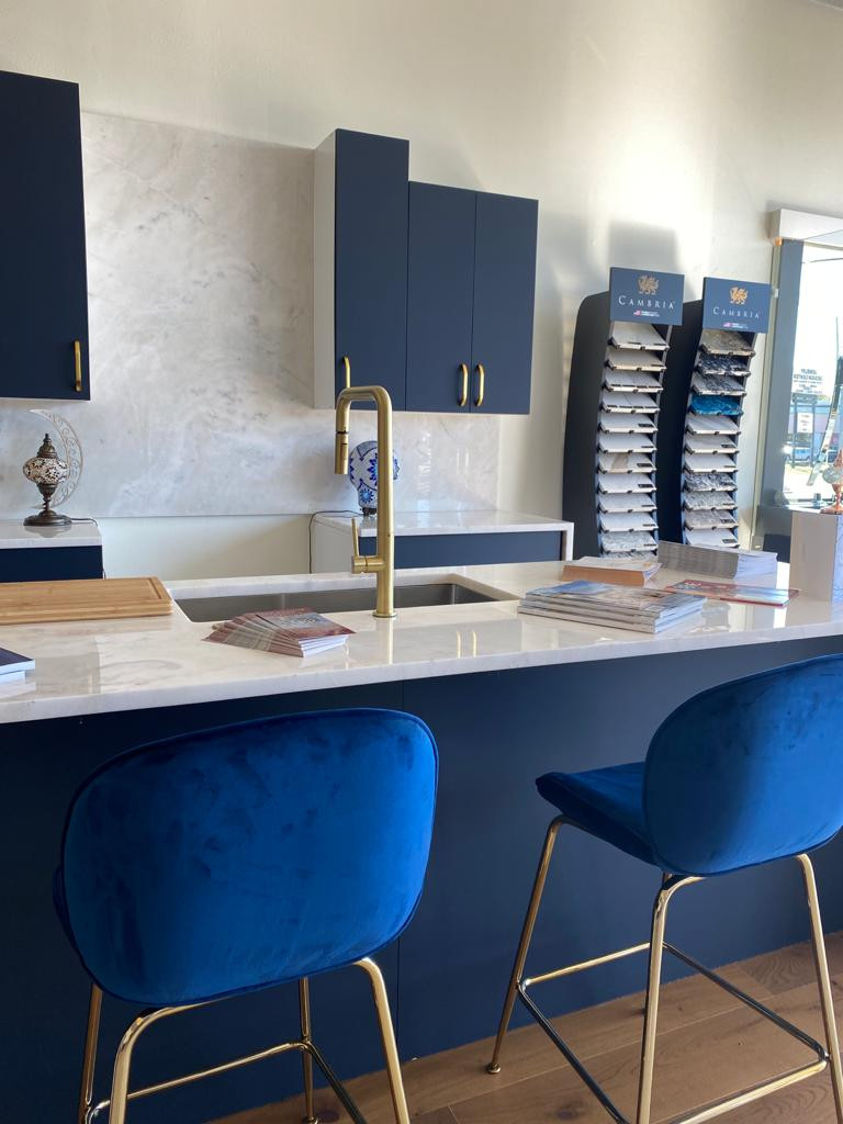 BLUE CABINETS WITH MARBLE WATERFALL ISLAND