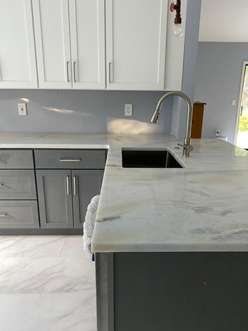 BLUE - WHITE CABINETS WITH MARBLE
