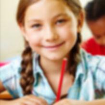 Primary school pupil smiling