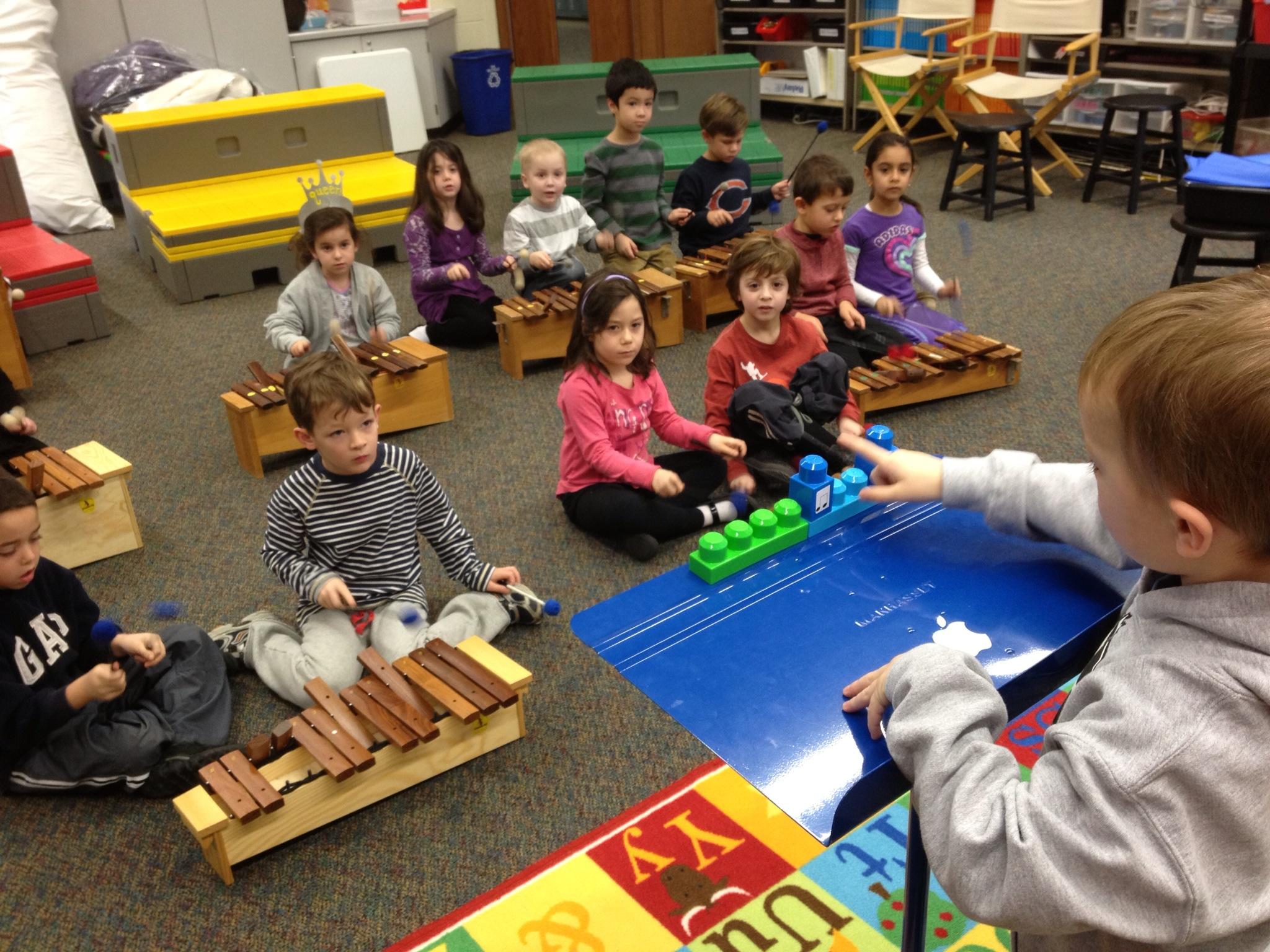 Kindergarteners conducting the beat
