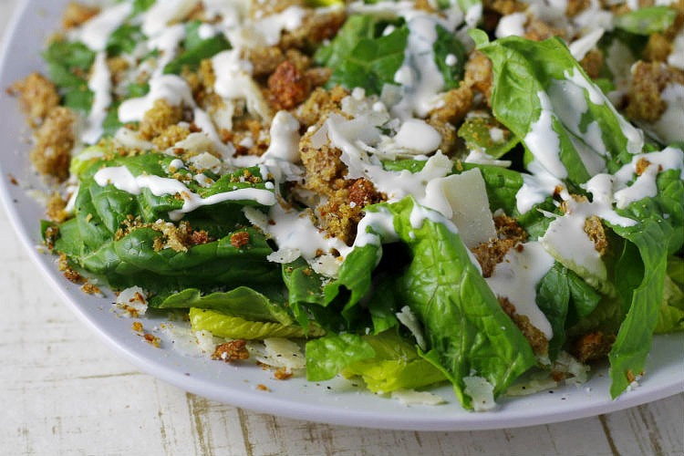 The Crushed Crouton Caesar Salad on white plate