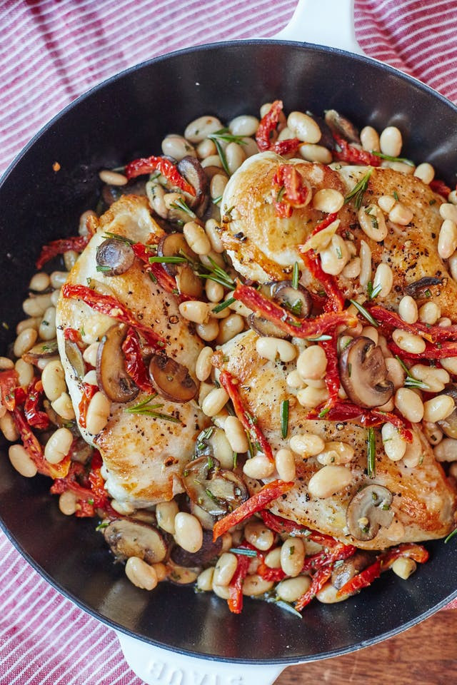 Chicken and white bean one skillet meal recipe with thyme and sun-dried tomatoes