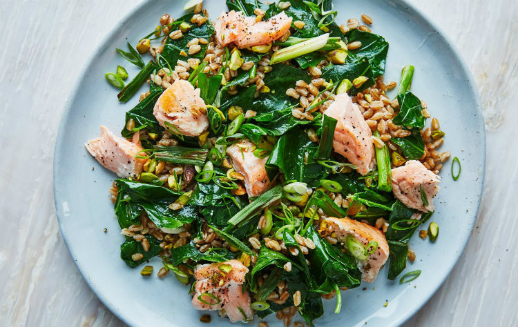Salmon and Farro Grain Bowl on blue plate with grey background