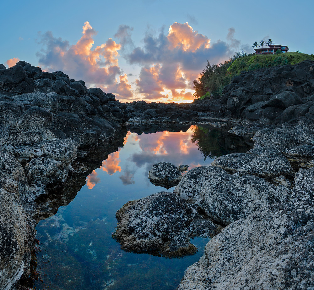 A sunrise over Queen's Bath on the island of Kauai in Hawaii.