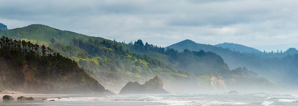 Misty waves roll onto the Oregon coast at Cannon Beach.