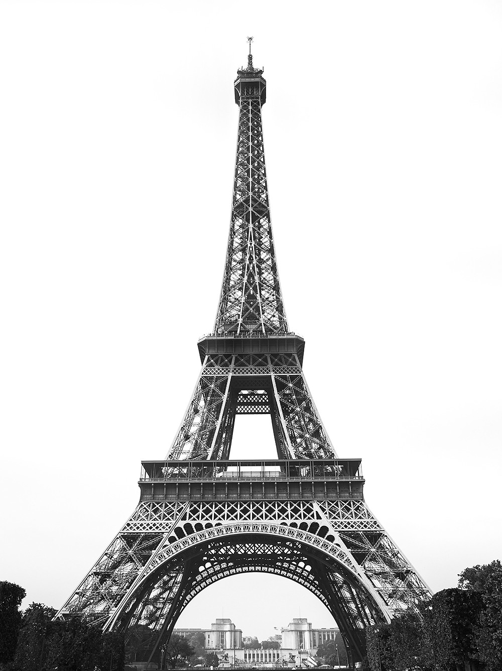 A direct angle of the Eiffel Tower in black and white.