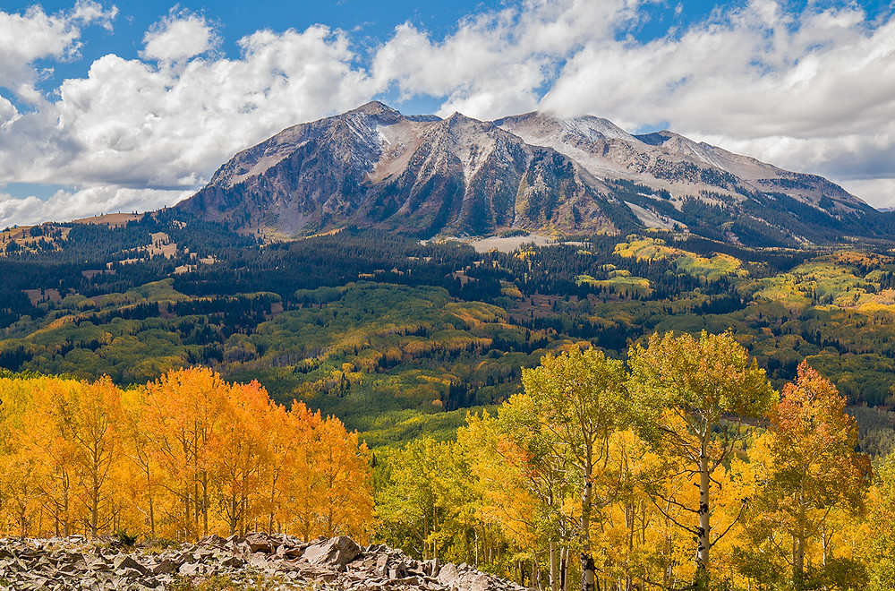 A mountain panorama in Crested Butte in fall with the aspens beginning to turn yellow.