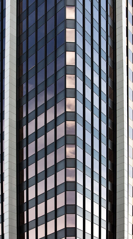 An urban landscape photograph of a skyscraper in downtown Denver.