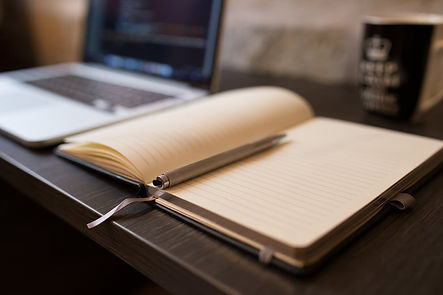 writing book with a laptop on a desk