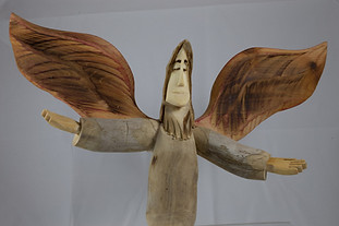 Pete Ortega angel woodcarving.