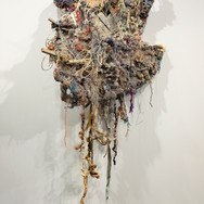 """Upheaving Roots I"" various discarded fibers, wood, and wire 5'x 2'x 17""  2019"