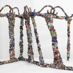 """To and Fro 36""""x 57"""" x 13"""" Shredded clothing from the inside of a punching bag, metal clothes drying rack, cotton string, worn bedsheets,wire, and adhesive. 2020"""