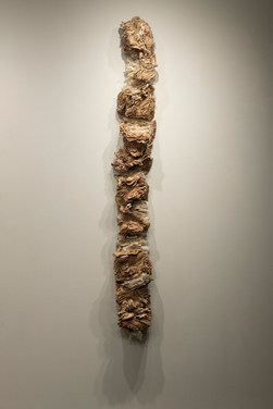 """Layered Identity II ceramic, mason stains, repurposed tracing paper, cheesecloth 68"""" x 12"""" x 7"""" 2018"""