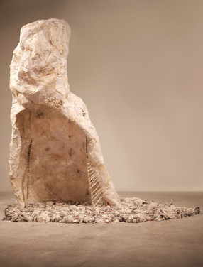 Chrysalis 7'x 6' x 3'  unfired reclaimed stoneware, insides of a punching bag, ticker tape, tracing paper, cheesecloth, stretch cotton linen, sticks, wax paper, natural refuse, fake sinew, and paste 2018