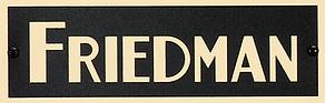 Friedman-logo_gold-on-black_with-screws.