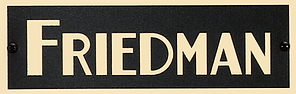 Friedman-logo_gold-on-black_with-screws.