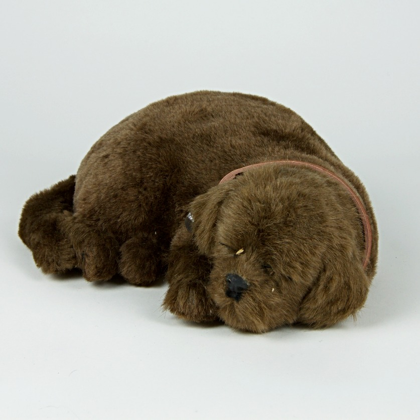 Battery operated breathing dog toy
