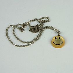 Acid house smiley face necklace