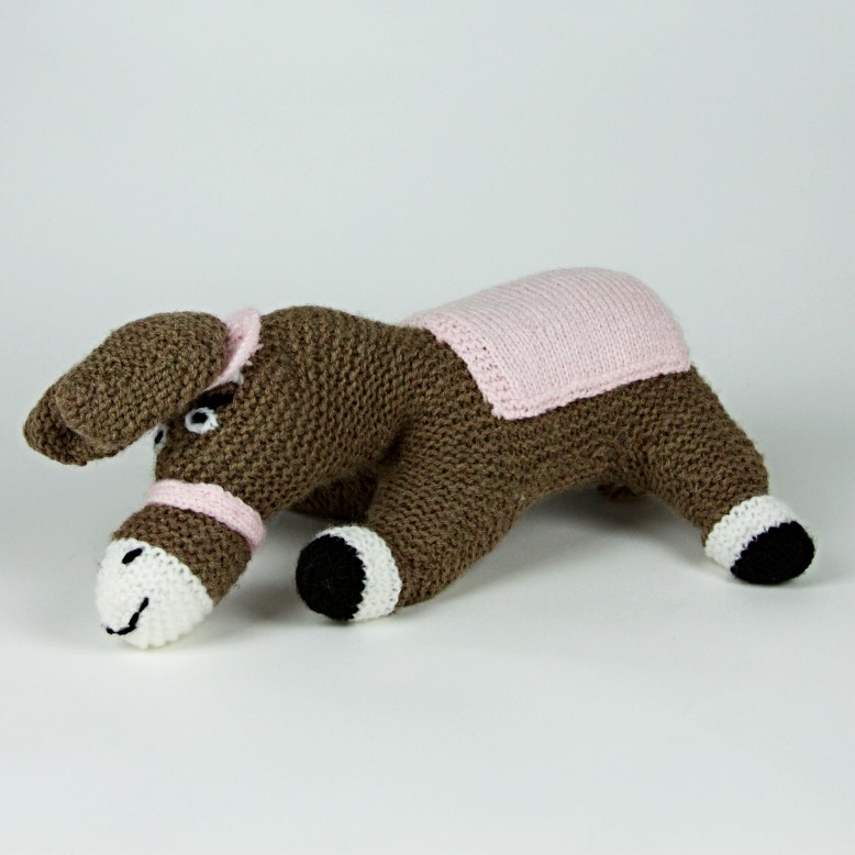 Knitted donkey soft toy