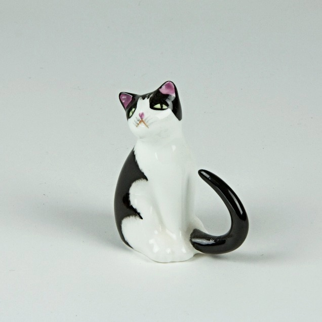 Curly tail cat ornament