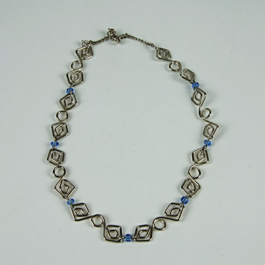 Silver patterned and beaded necklace